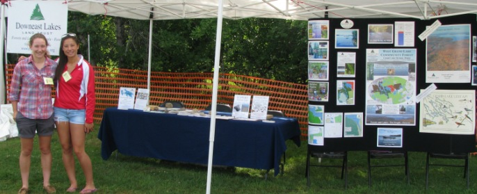 Interns at DLLT Booth at Grand Lake Stream Folk Art Festival