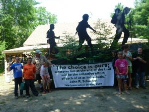 Local children building the Downeast Lakes Land Trust's 4th of July Parade Float which honored John R. Schaefer's  prophetic vision.